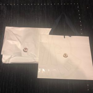 Moncler bag and paper